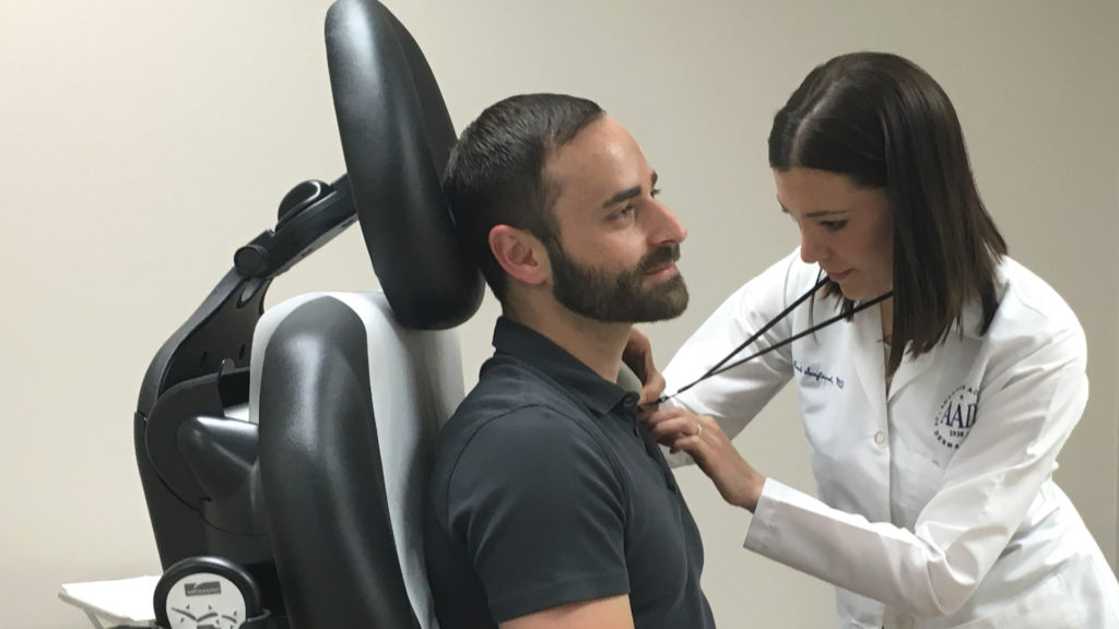 Dr Sanford Examining Patient